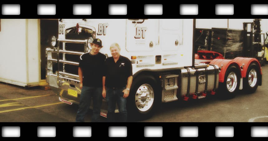 Josh and Mal Beattie standing in front of a BT prime mover