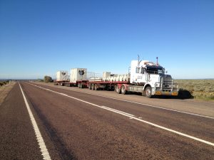 Triple road train truck loaded with concrete precast building products