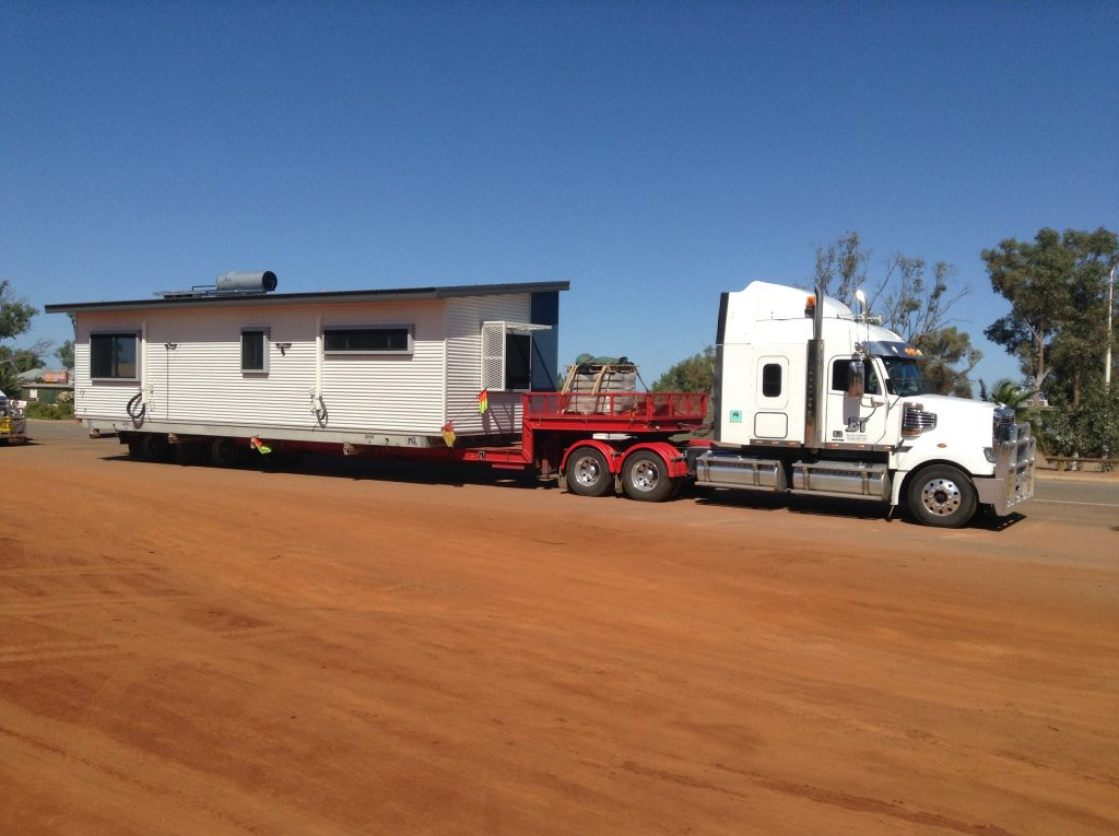 Truck with portable building loaded