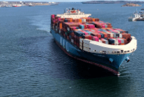 loaded container ship entering a harbour