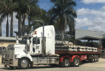 truck with concrete sleepers loaded onto trailer