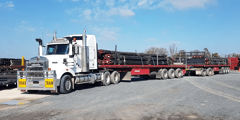 Truck loaded with long pipes