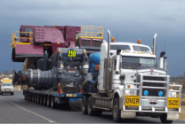 Large machine loaded onto heavy haulage trailer for an oversize transport delivery